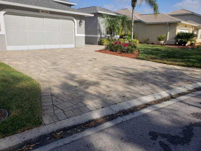 Home in Whiskey Creek, FL before we sealed their driveway pavers