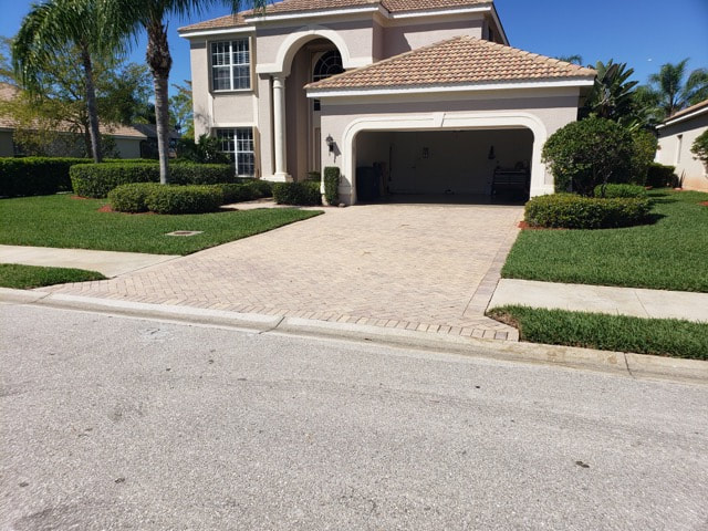 Driveway brick pavers prior to getting sealed at home in Golden Gate, FL.