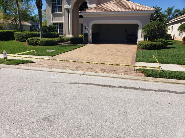 Driveway brick pavers after getting sealed at home in Golden Gate, FL.