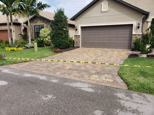 Driveway pavers with new sealant at home in Immokalee, FL.