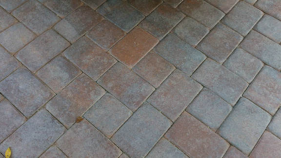 grayed pavers due to solvent sealer