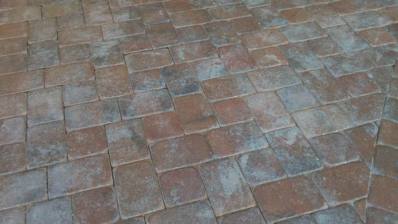 brick pavers with trapped moisture due to high-solids sealant