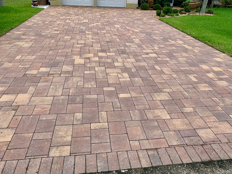 Driveway at home in Naples Park before sealing its brick pavers.