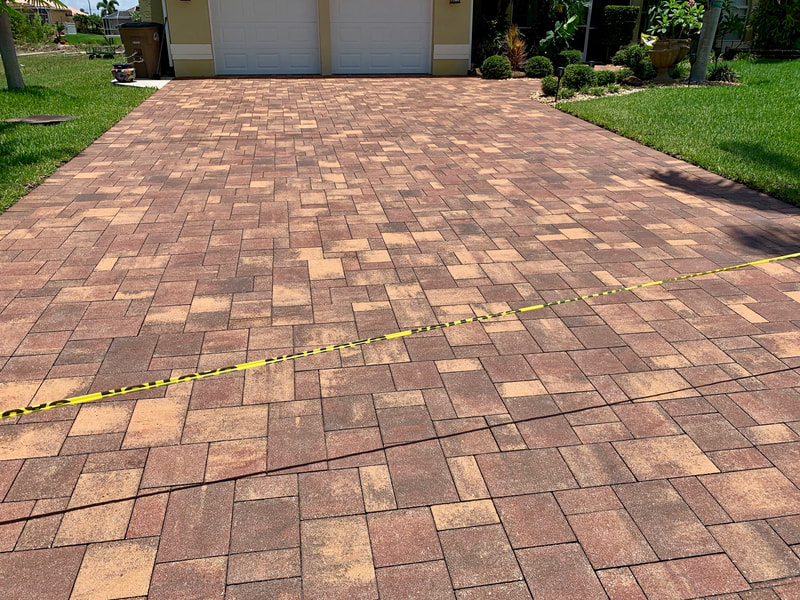 Driveway at home in Naples Park with its brick pavers newly sealed